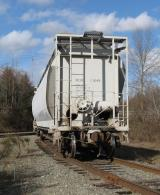 A freight car on a spur next to main line